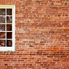 Old Brick Wall with White Window