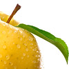 Golden Delicious Apple with Water Drops on White Background