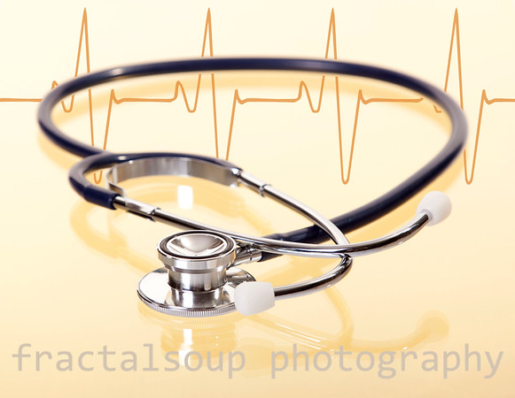 Stethoscope with Reflection on Gold and Heartbeat