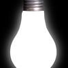 White Lightbulb on Black Background with Glow