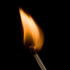 Brilliant Match Flame on Black Background