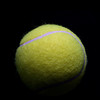 Heavily Shaded Tennis Ball on Black Background
