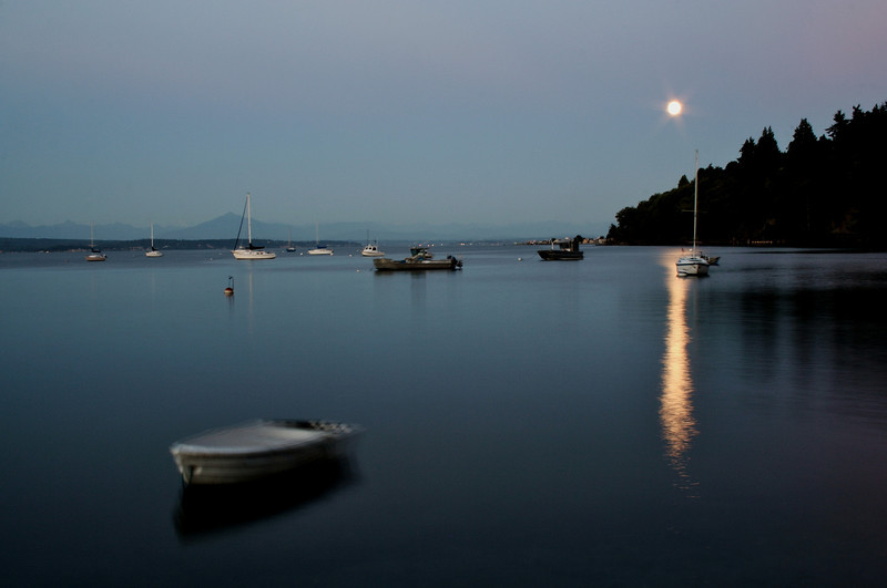 Boats on the Water Beneath a Full Moon