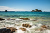 Ocean Waves crashing against rocky shore in New Zealand