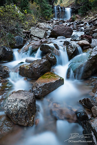 Small cascade under larger waterfall on creek in Colorado.