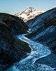 River through narrow canyon toward the peak of Mt Aspiring