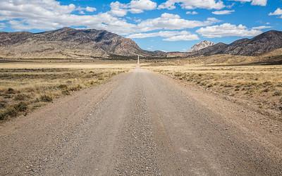 Dirt road through Utah desert toward Crystal Peak