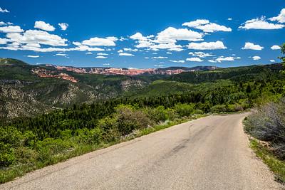 Road leading toward distant Cedar Breaks National Monument.