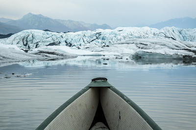Gray smokey day paddling among the icebergs of the Matanuska Glacier.