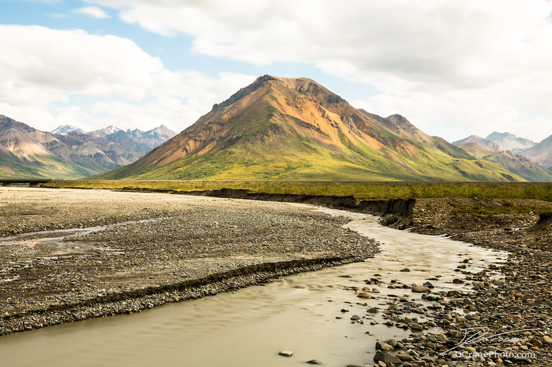 Small mountain and river inside Denali National Preserve