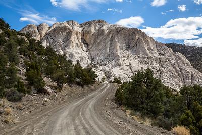 Summit of Crystal Peak over dirt road through the desert.