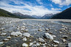 Rocky shallow river in glacial valley of New Zealand