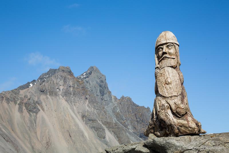Wood Viking Sculpture and Rocky Peak