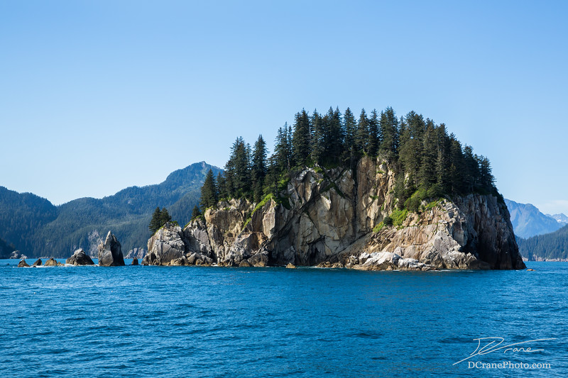 Rocky island off the coast of Seward, Alaska