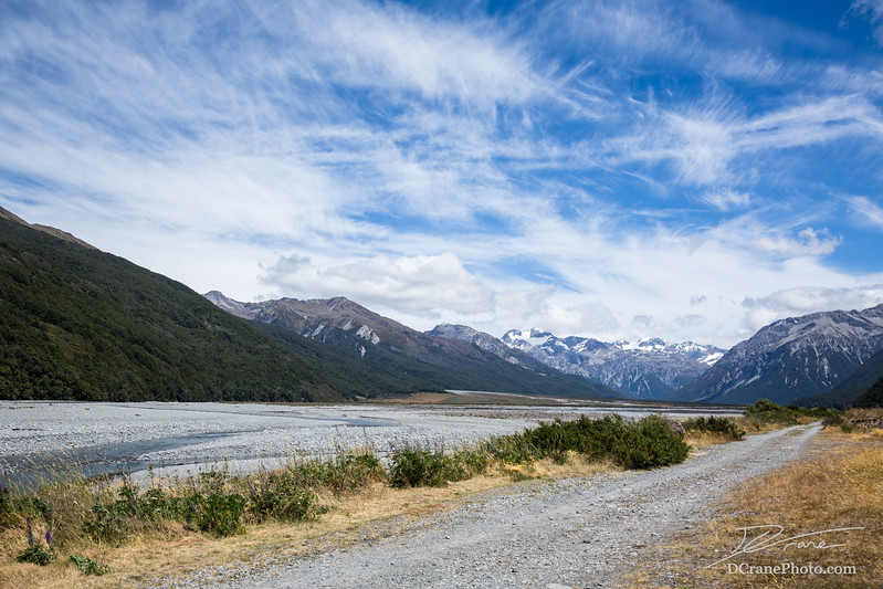 Gravel road along braided river of New Zealand's Southern Alps