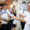 The conductor of Maestro Tejera Brass  Band during an outdoor performance, Alameda de Hercules square, Seville, Spain