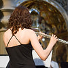 Girl playing the flute inside San Luis de los Franceses church, Seville, Spain