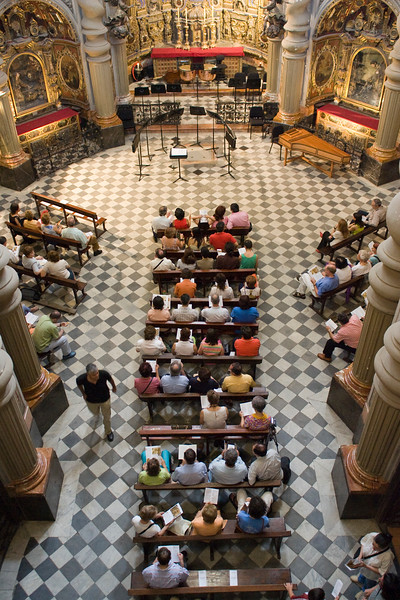 People sitting inside San Luis de los Franceses church before a classical music concert, Seville, Spain