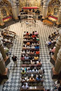People sitting inside San Luis de los Franceses church before a classical music concert, Seville, Spain