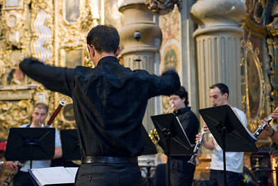 Classical music conductor during a concert in San Luis de los Franceses church, Seville, Spain