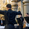Classical music conductor during a concert in San Luis de los Franceses church, Seville, Spain