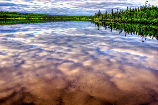 Lake relecting the cloud and sky above