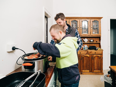 Young Man Cooking a Meal with Support Worker
