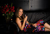 Young Woman Lounges on Couch drinking a Glass of Wine