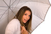 Attractive Young Woman under an Umbrella