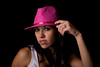 Beautiful Hispanic Woman on Black Background with Pink Hat
