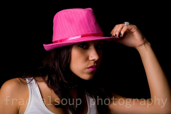 Sultry Woman in Pink on Black Background