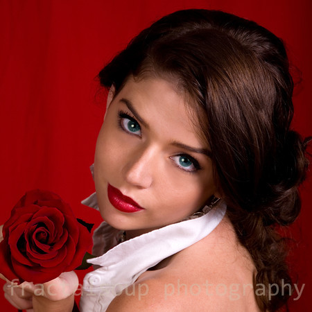 Beautiful Woman with Rose on Red Background