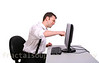 Angry Young Business Man Punching a Computer Monitor Isolated on White Background