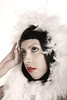 Beautiful Hispanic Woman with Feather Boa in Muted Pastel Colors