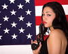 Young Hispanic Woman with Gun and American Flag