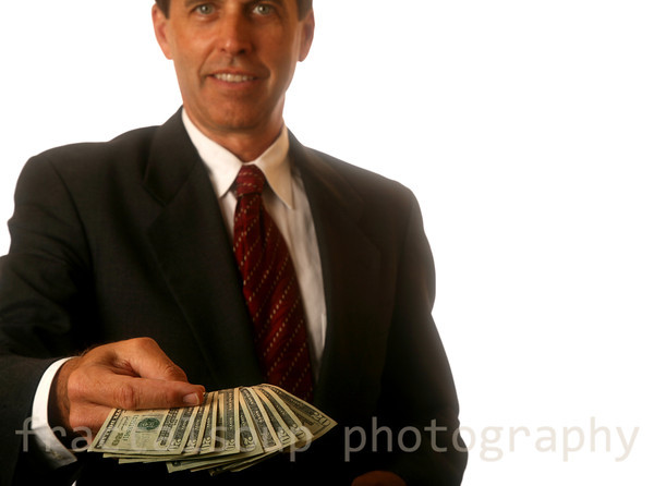 Handsome Businessman Presenting Money for Purchase