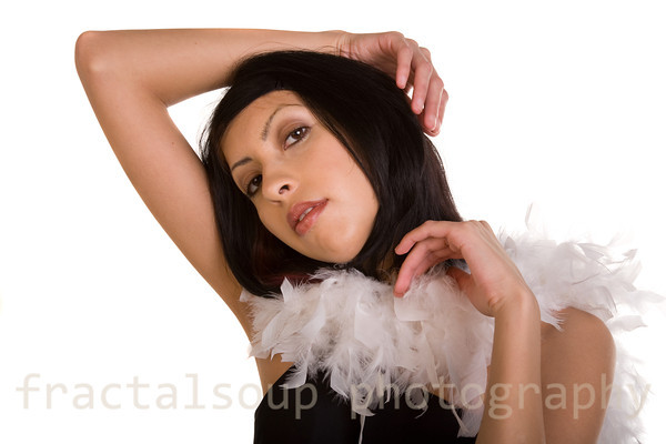 Elegant Hispanic Woman with White Feather Boa Isolated on White