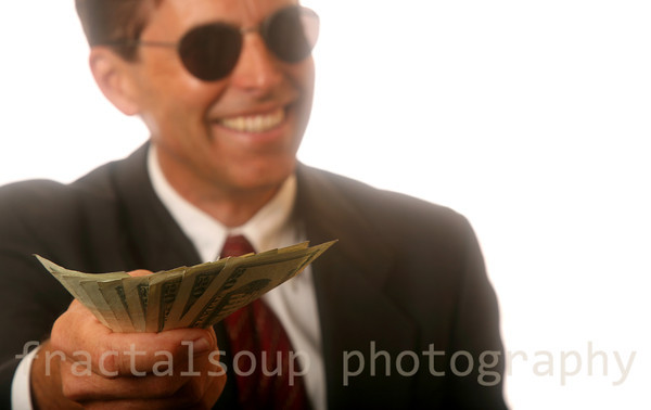 Handsome Man in Sunglasses presenting Money