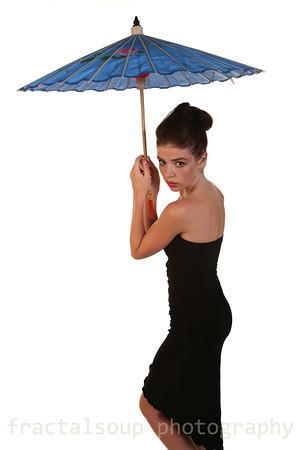 Beautiful Young Woman in Elegant Black Dress and Colorful Umbrella