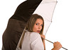 Attractive Young Woman under Umbrella with Concerned Look
