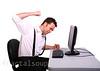 Frustrated Man working at at Computer Terminal