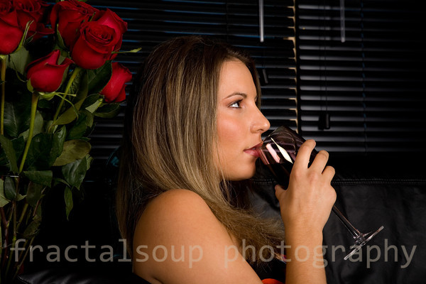 Beautiful Young Woman Having a Drink of Red Wine