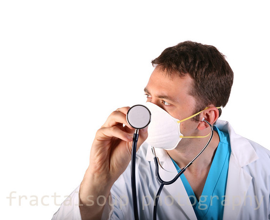 Young Male Doctor Listens Intently through Stethoscope