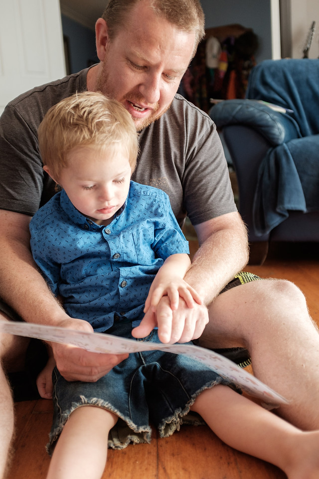 Dad with his Boy looking at Alphabet Chart