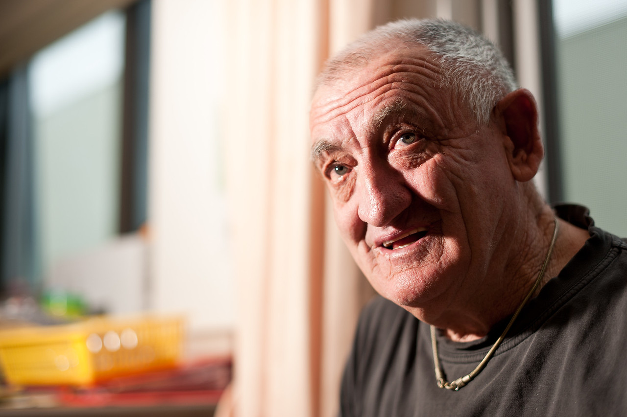 Head shot of a sixty-nine year old man, made with a wide aperture to create a blurred background.
