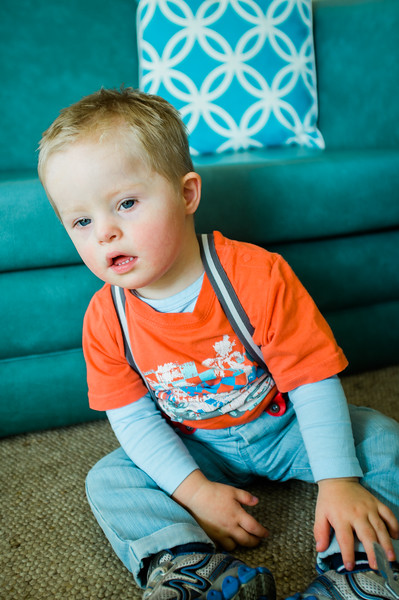 Two-and-a Half Year Old Boy seated on the Floor
