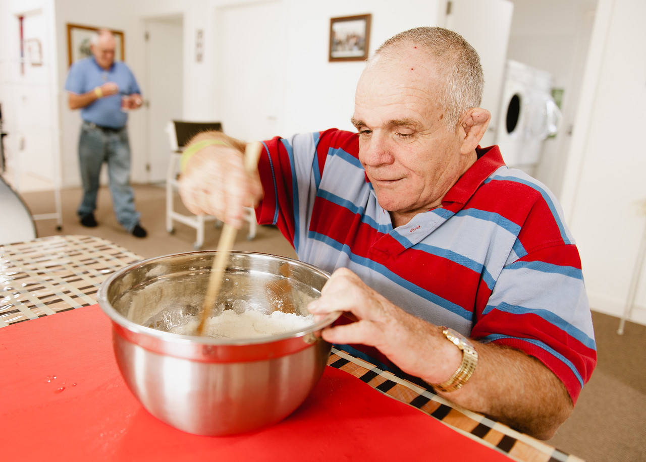 Man with an Intellectual Disability mixing at a Table