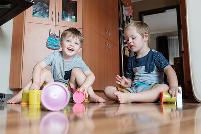 Boys Playing on The Floor in Kitchen