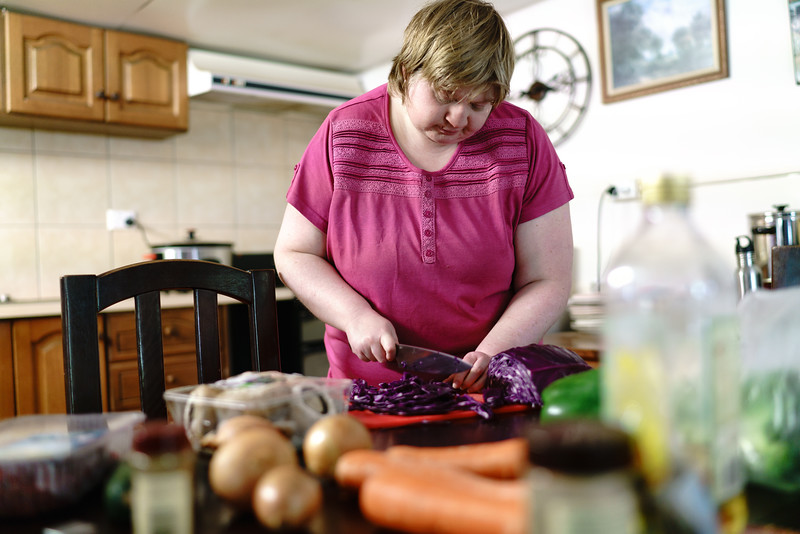 Woman chopping Red Cabbage in a Kitchen