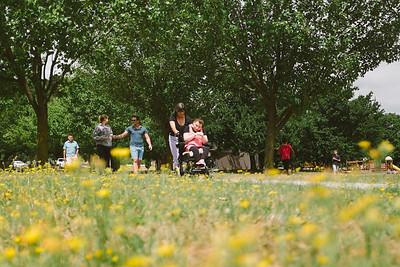 Family out for a walk in a park